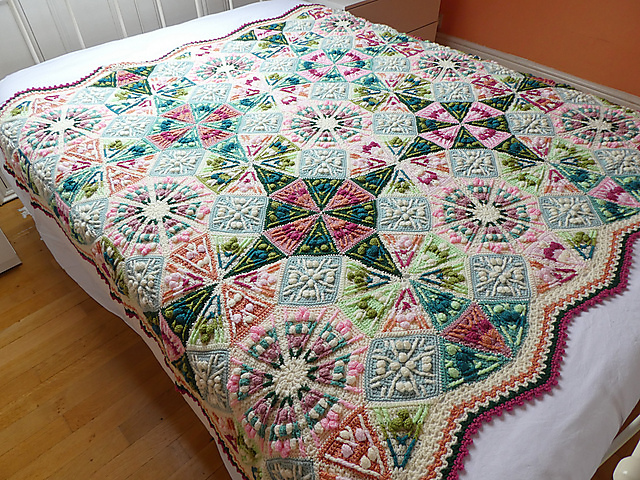 Finished Kaleidoscope Blanket in Old Rose colour scheme. Photo copyright Catherine Bligh